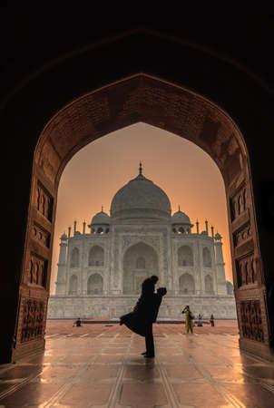 Agra,Utter Pradesh / India - October 13,2019. Silhouette of Couple in front of Taj Mahal .