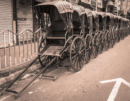 Historical Hand Pulled Rickshaw parking on the Road side.