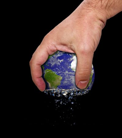 squeezing: Hand squeeze planet earth Stock Photo