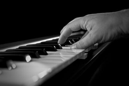 hand at piano photo