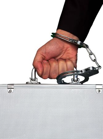 financial security: hand with handcuff and a suitcase Stock Photo