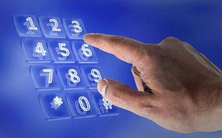 Real hand in a virtual keypad Stock Photo - 8222179