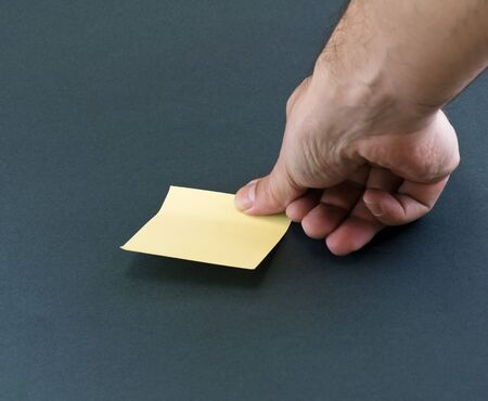 Hand and a Post-it photo