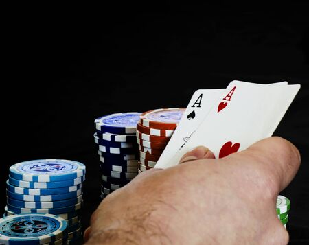 Hand with a pair of aces photo