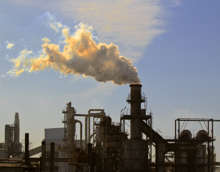 chemical industry: air pollution by one big chimney of a factory Stock Photo