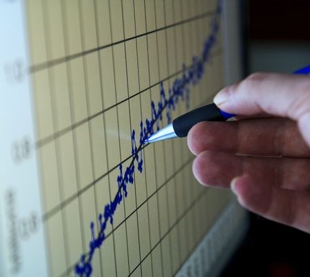 analyzing a graph in a computer monitor Stock Photo - 9350973