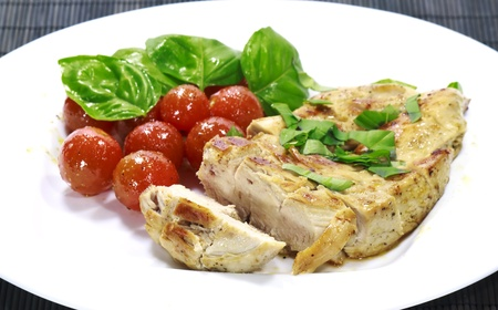 Chicken steak with a tomato salad photo