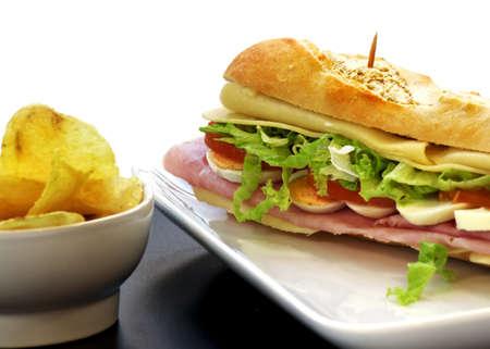 pan frances: Sandwich con tomate de huevo jam�n queso Foto de archivo