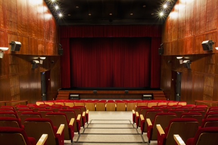 red stage curtain: auditorium with red chairs and red curtain