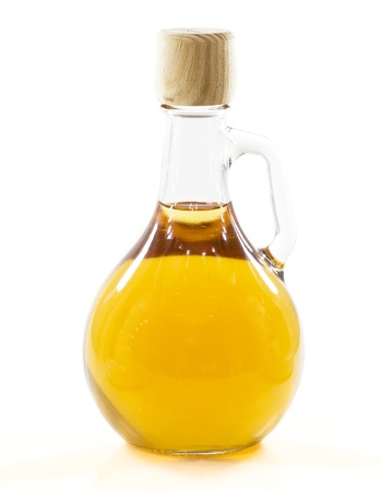 olive oil bottle: bottle with yellow liquid in a white background