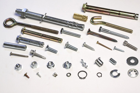Metal bolts and screws on white background 写真素材