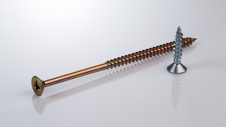 Metal bolts and screws on white background Standard-Bild