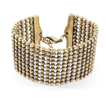 gold metal: Antique Gold Metal Ball Bracelet Stock Photo