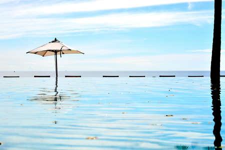 hua: sea sand sun swimming pool beach front resort in cha am hua hin thailand Stock Photo