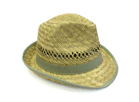 Yellow straw hat on a white background