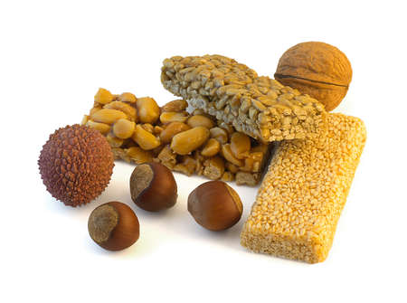 Oriental sweets and nuts on white background photo