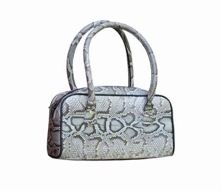 Lady's handbag made of piton isolated on white photo