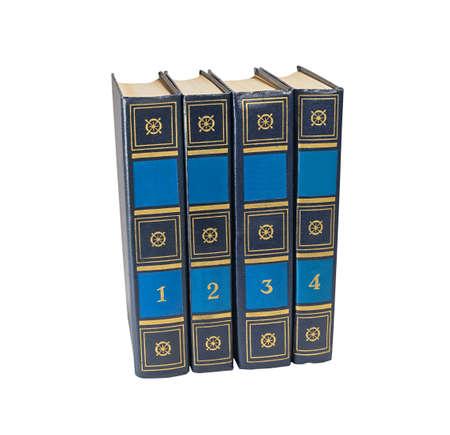 volumes: Four book volumes on white background Stock Photo