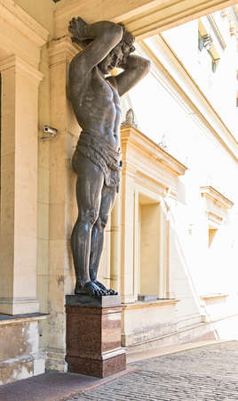 atlantes: Granite telamon in front of Hermitage museum in St. Petersburg, Russia. Stock Photo