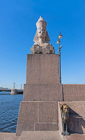 winged lion: Sphinx statue and bronze winged lion on the University Universitetskaya embankment in St. Petersburg, Russia.