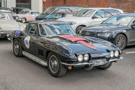 corvette: Moscow, Russia - April 24, 2016: Retro cars rally named after Ingosstrakh Exclusive Classic Day. Chevrolet Corvette Sting Ray Convertible.