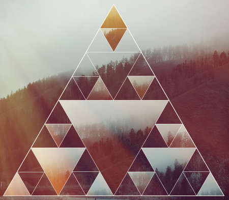 Abstract background with the image of the forest, mountains and the sacred geometry symbol triangle. Harmony, spirituality, unity of nature. Collage, mosaic. Stock Photo