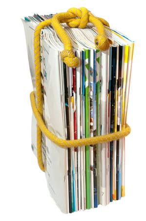 a stack of magazines on the rope photo