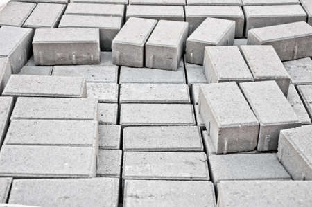 concrete blocks: blocks of gray stone blocks for paving sidewalks