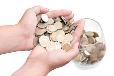 in the hands of a stack of coins Stock Photo