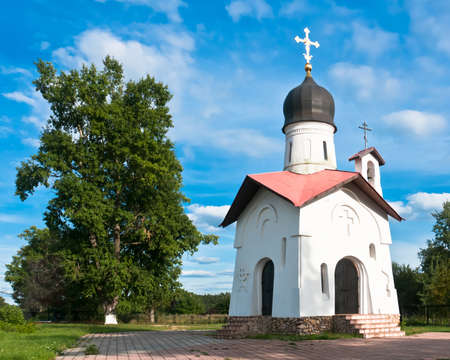 Christian chapel, the trees and clear blue sky Stock Photo