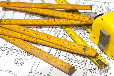 construction drawings and measuring-tape
