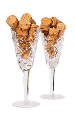 crystal wine glasses with champagne corks from inside Stock Photo