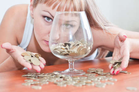 young girl with the cash in a glass Stock Photo - 10330624