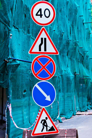 roadwork: signs against the building structures