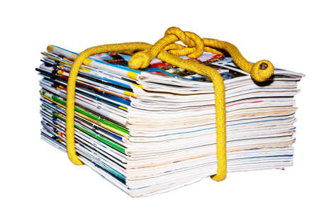 a stack of magazines on the rope Stock Photo