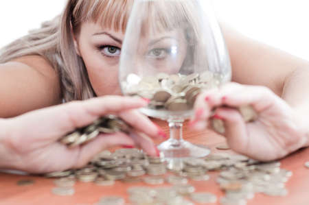a young girl, money, a glass goblet Stock Photo - 10330622