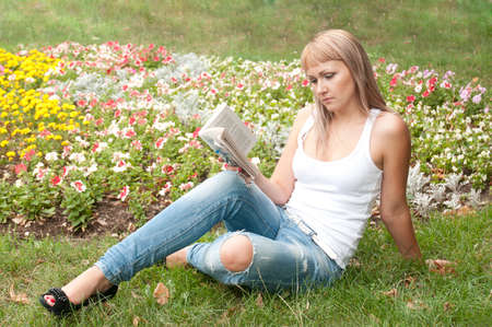 girl in the garden reading a book photo