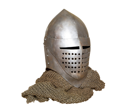 old knight helmet and chain mail for protection in battle. is made of metal. of knightly armor