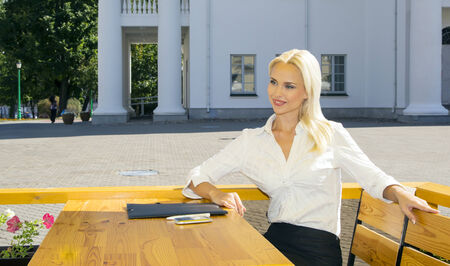 light hearted: Portrait of a business woman in a summer cafe on a sunny summer day Stock Photo