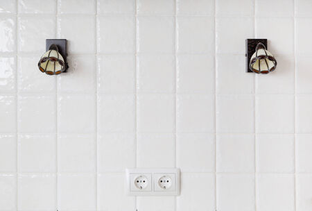 sconce: kitchen, a fragment of a wall of white tiles, sconce