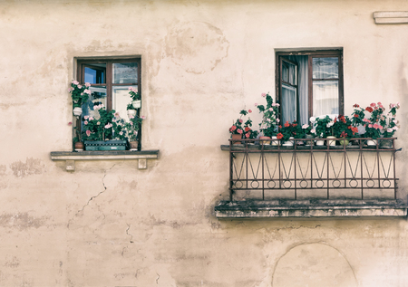 balcony window: open window, balcony with flowers on the windowsill, in the old style photo image.