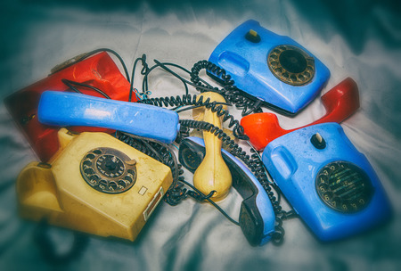 turn dial: heap of old broken phone, Soviet production, photo in old style image.