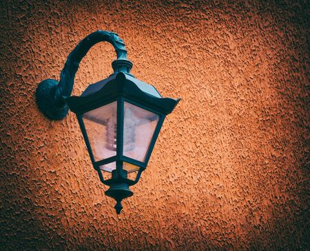 oldstyle: old street lamp, metal, closeup, old-style photo image.