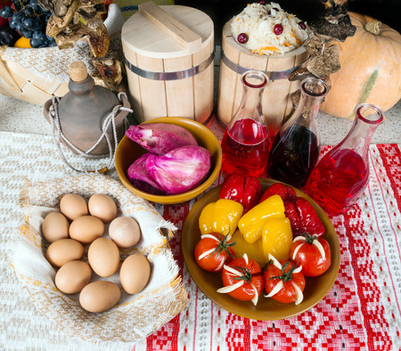 rustic still life, pickled cabbage, peppers, tomatoes, alcohol, eggs photo