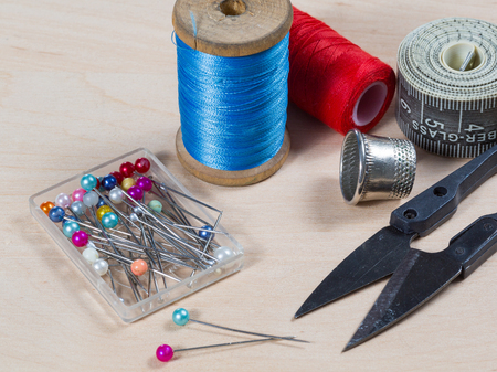 darning needle: Still life with scissors, thread, pins. tool tailor. photo in old style image