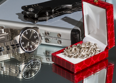 jewelry chain: Business still-life watches a penknife and jewelry chain on a light background Stock Photo
