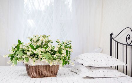 Jasmine flowers in a basket on the bed background white curtains jasmine flowers in a basket on the bed background white curtains bedroom a mightylinksfo