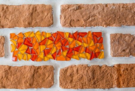 glass brick: fragment of brick wall and inserted glass mosaic. background, interior