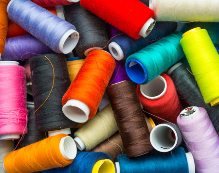 craft background: many colorful spools of thread closeup. sewing, craft. background, wallpaper