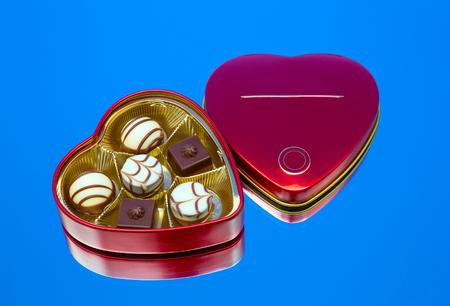 metal box: candy, metal box lying on a mirror. fragment, still life, wallpaper
